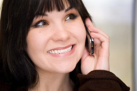 attractive brunette woman talking by phone Stock Photo - 4304239