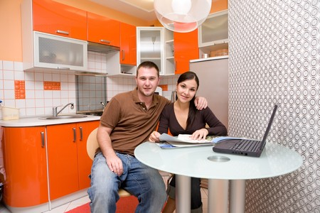 happy couple together in modern kitchen photo
