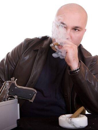 danger  man smoking cigar. over white background photo