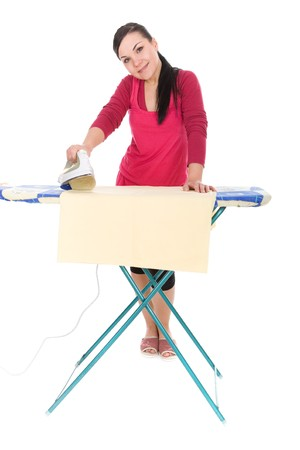attractive brunette woman ironing. over white background
