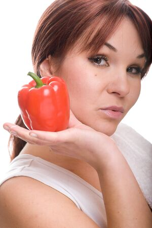 healthy woman with pepper. over white background photo