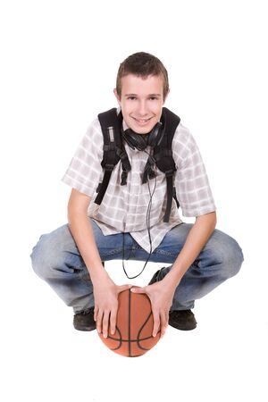 casual teenager ready to school with basketball photo