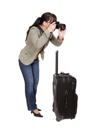 attractive brunette woman with suitcase. over white background photo