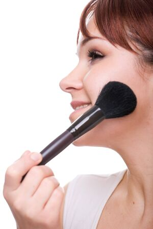 attractive woman doing makeup. over white background Stock Photo - 4512318
