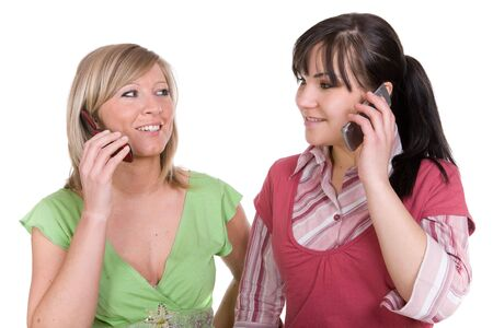 two attractive women with mobile phones photo