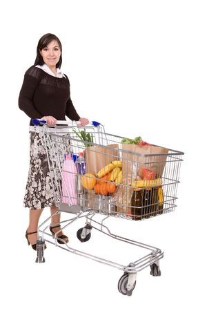 happy brunette woman with shopping cart. over white background Stock Photo - 4737207