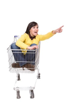 happy brunette woman with shopping cart. over white background Stock Photo - 4737384