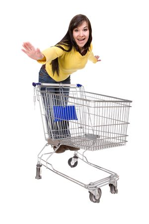 happy brunette woman with shopping cart. over white background Stock Photo - 4737369