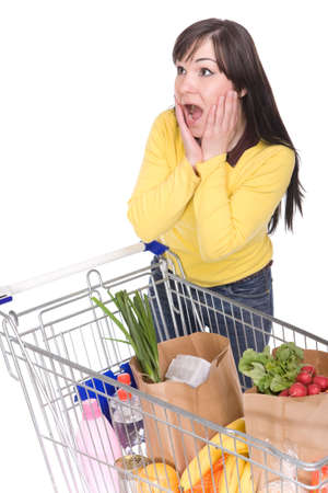 woman shopping cart: happy brunette woman with shopping cart. over white background