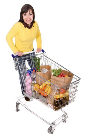 happy brunette woman with shopping cart. over white background Stock Photo - 4737452