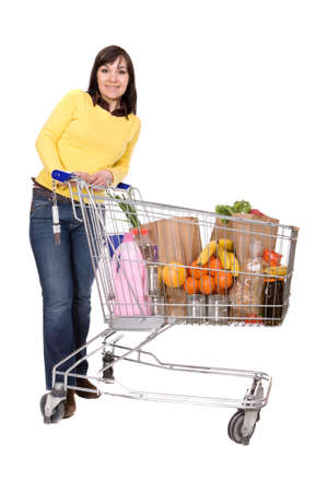 happy brunette woman with shopping cart. over white background photo
