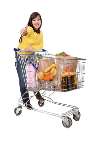 happy brunette woman with shopping cart. over white background