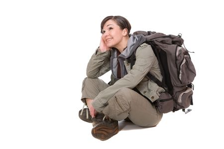 attractive brunette woman ready to travel. over white background Standard-Bild