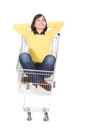 attractive brunette woman with shopping cart photo