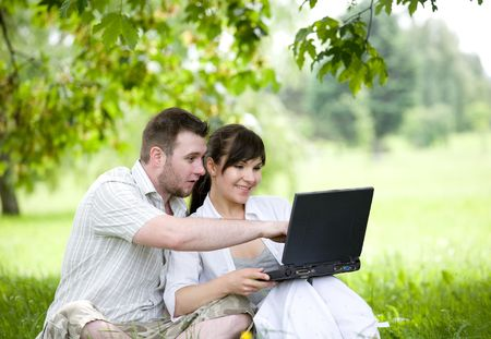 happy young couple relaxing in park Stock Photo