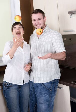 happy young couple having fun in kitchen Stock Photo - 5417438