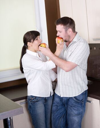 happy young couple having fun in kitchen Stock Photo - 5417428