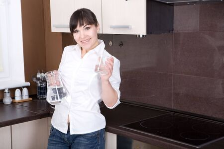 happy young woman having break in kitchen photo