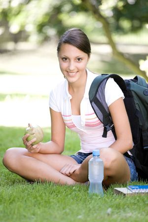 happy young woman learning in park photo