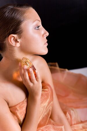 young beautiful woman with perfume Stock Photo - 5551072