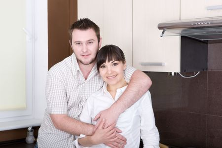 happy young couple in kitchen photo