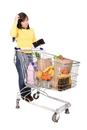 shoppingcart: young happy woman with shopping cart. over white background