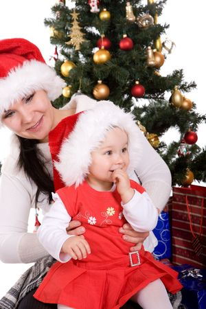 mother and daughter preparing christmas tree photo