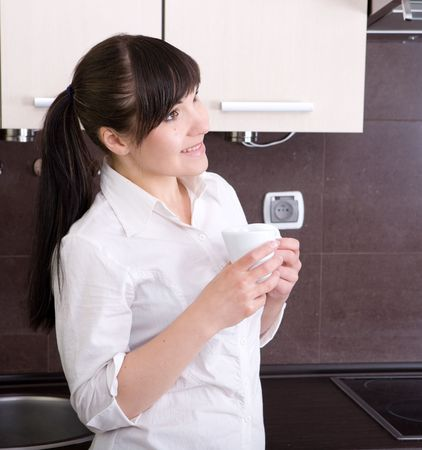 young beautiful woman in kitchen photo