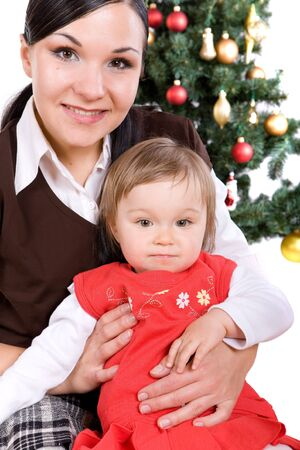 mother and daughter over christmas tree Stock Photo - 5638993