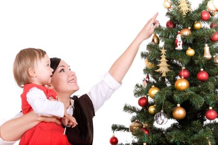 mother and daughter over christmas tree photo