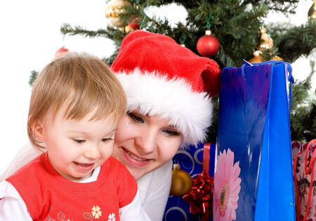 mother and daughter over christmas tree Stock Photo - 5638977
