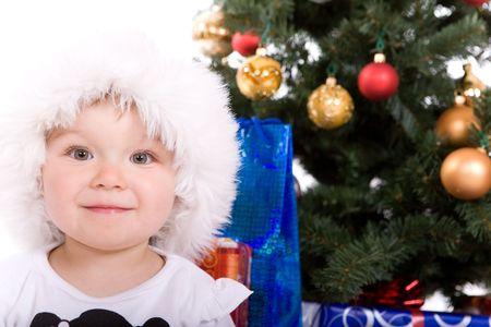 happy baby girl over christmas tree photo
