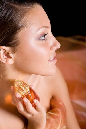 young beautiful woman with perfume Stock Photo - 5686982