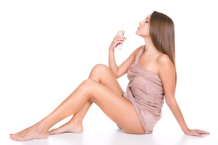 young beautiful woman with bottle of perfume Stock Photo