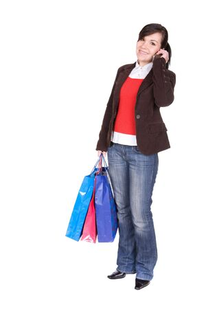 young attractive brunette woman with shopping bags. over white background Stock Photo - 5857096