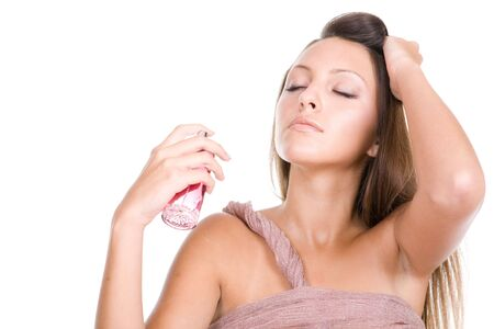 young beautiful woman with bottle of perfume photo