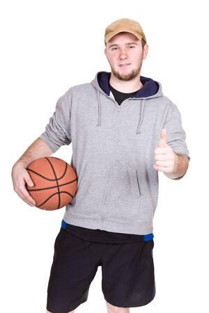 happy young man with basketball. over white background photo