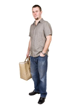 young casual man with shopping bag. over white background photo
