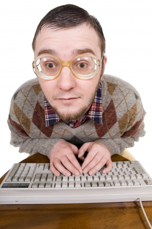 silly nerd with keyboard. over white background photo