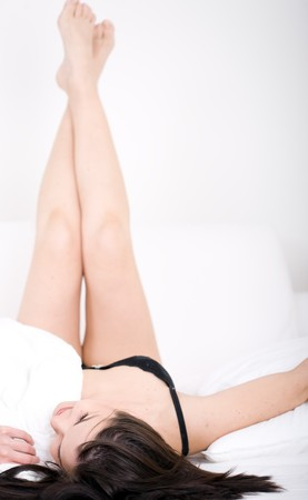 young attractive brunette woman lying in bed Stock Photo - 6915193