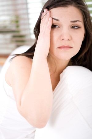young adult brunette woman feeling pain in bed photo