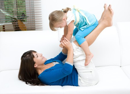 mother and daughter having fun at home Stock Photo - 7848883