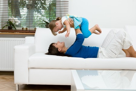 young mother and her daughter playing at home Stock Photo - 7848955