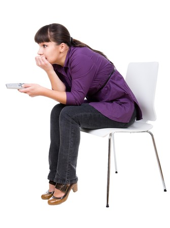young adult woman watching tv. over white background photo