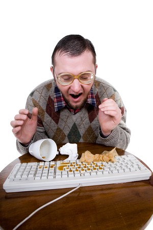 silly man with broken keyboard. over white background photo