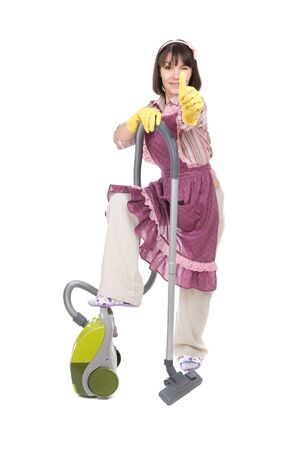 young adult woman with vacuum over white background photo