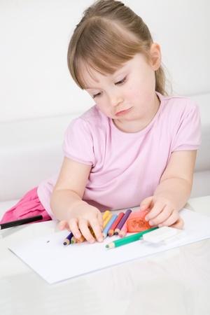 sweet little baby girl drawing photo
