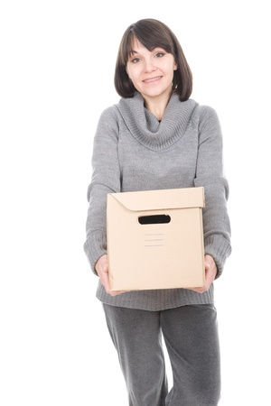 young adult brunette woman holding cardboard box. over white background Stock Photo - 8980050
