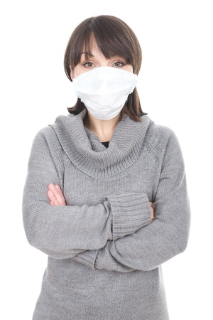 young adult brunette woman with medical mask photo