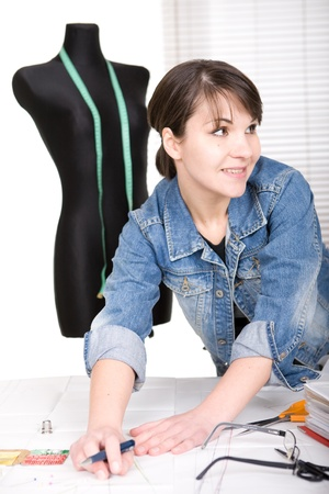 designer clothes: young adult fashion designer at work Stock Photo
